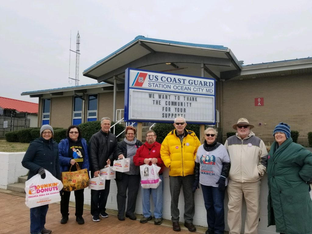 Members of the DWC and Indivisible Worcester delivered coffee and donuts to the U.S. Coast Guard Station in Ocean City during the January 2019 government shutdown.
