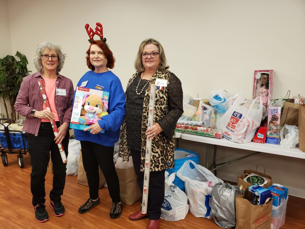 Karen Matheson, Priscilla Zytkowicz, and Vicky Wallace Collecting for Santa Sacks for the Worcester County Detention Center detainees to provide Christmas gifts for their children. 111819